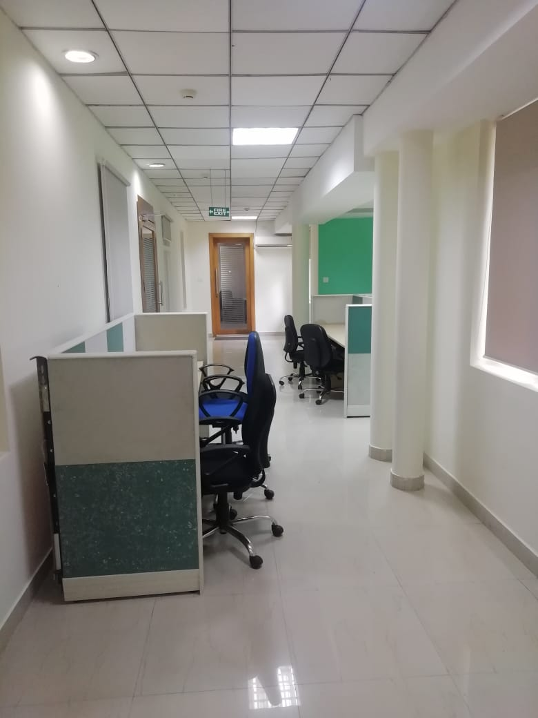 The electronic equipment/computer hardwares/ clocks/access control devices/CCTV/ Phones etc. shown in the image are not a part of our offer.<br>The Plug and Play offices shall be fully furnished offices with state of the art IT office tables and chairs with AC and power connections pre-installed.